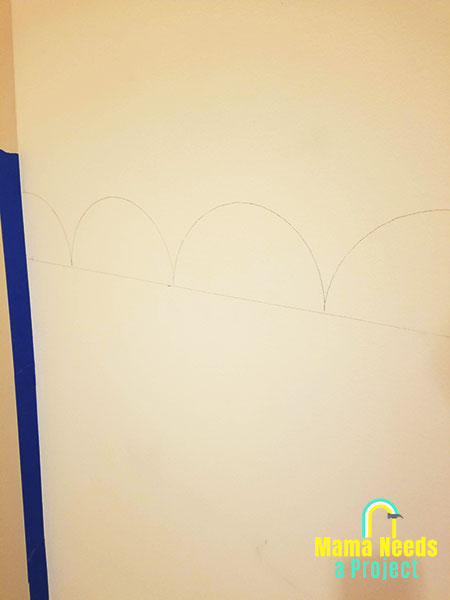 scallop outline drawn onto wall