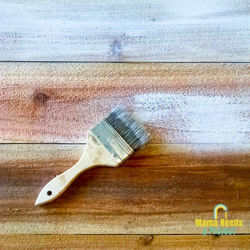 dry brushing to create rustic finish for fence picket welcome signs