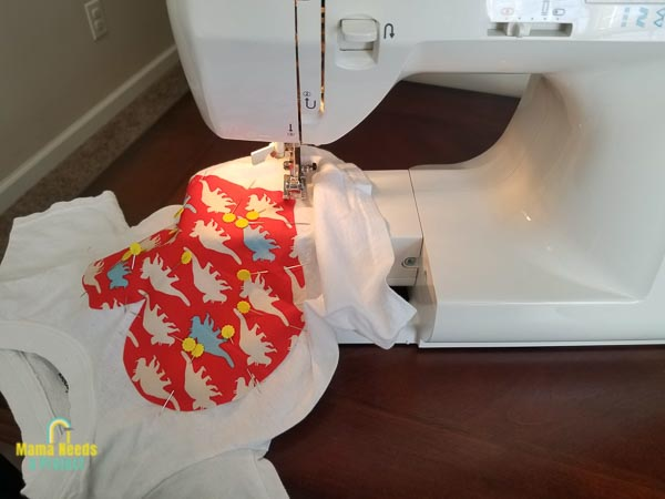start sewing applique shape to shirt