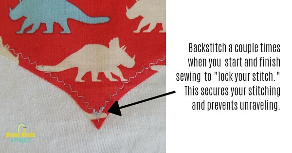 close up of backstitching to lock stitches for applique heart shirt