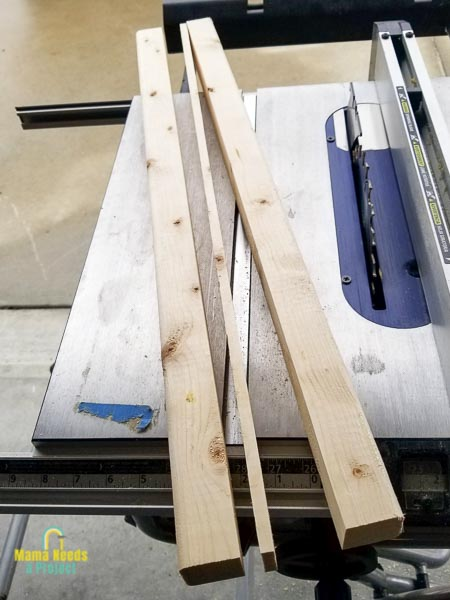 rip 2x4s down to 2x2 size with a table saw