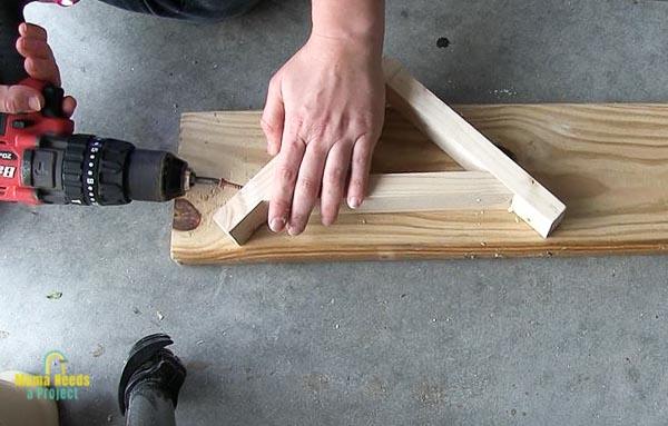 use wood screws to attach diagonal support for diy wood shelf bracket