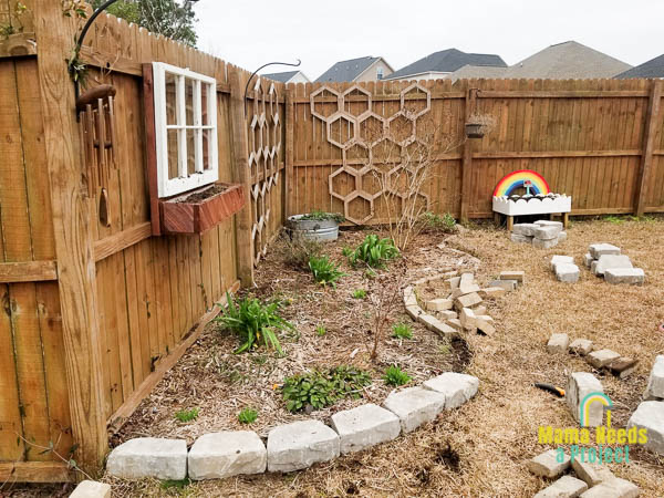 replacing stone border to prepare garden for spring