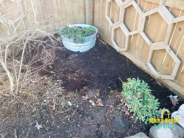 fill low spots in flower bed with new soil