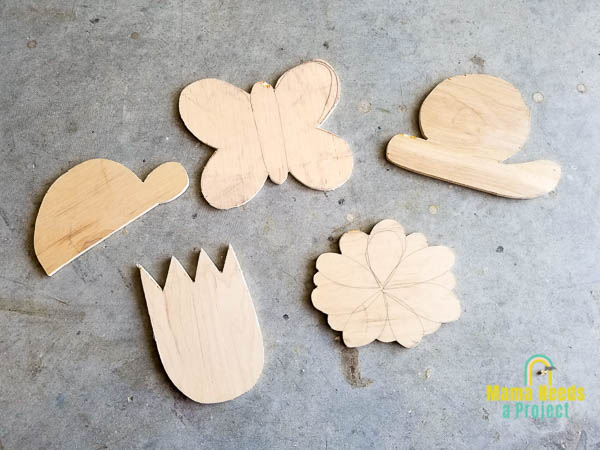 DIY garden signs cut out of scrap plywood