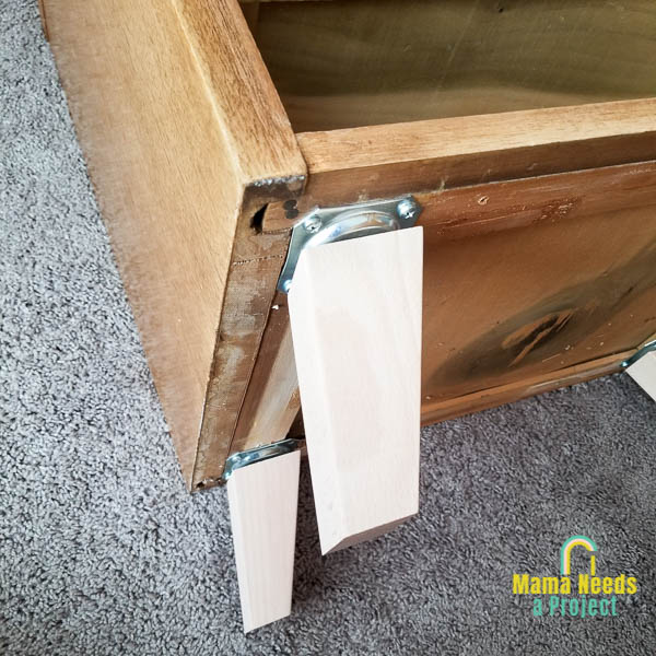 attach legs to furniture using leg plates on base of dresser