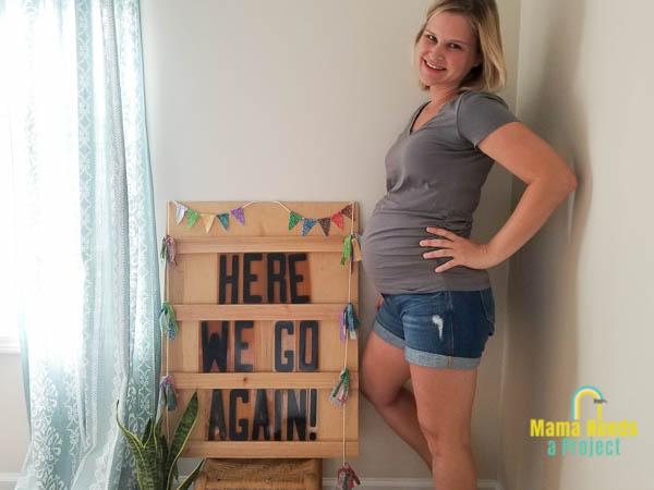 big letter board pregnancy announcement