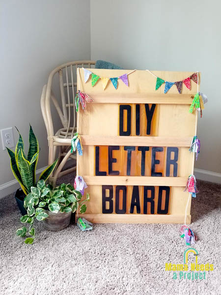 DIY Letter board photo with plans and a rattan chair in a corner