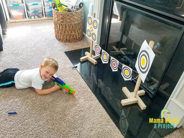 boy smiling with nerf gun and diy nerf gun targets