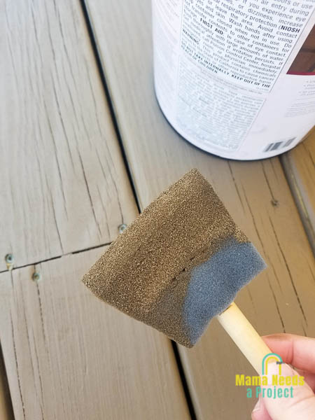 use foam brush to stain between wood deck boards