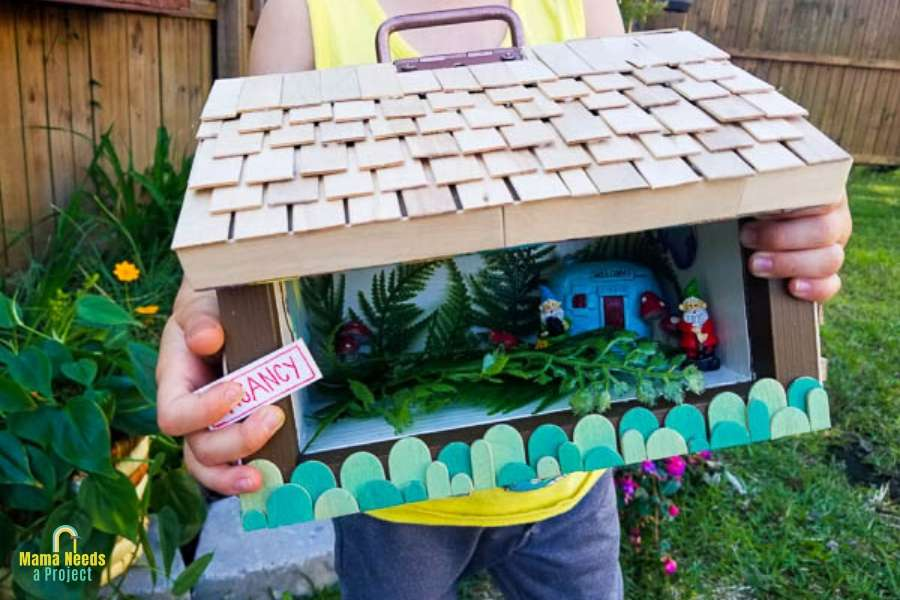 diy bug house scrap wood project child holding bug house
