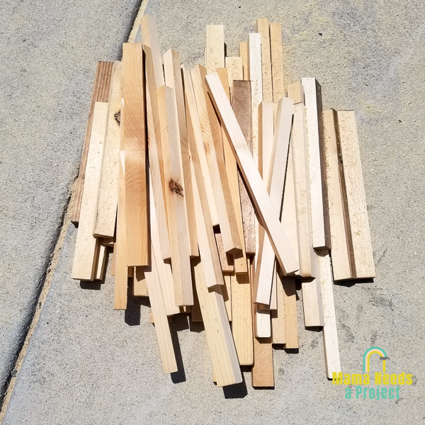 strips of wood on cement for geometric design