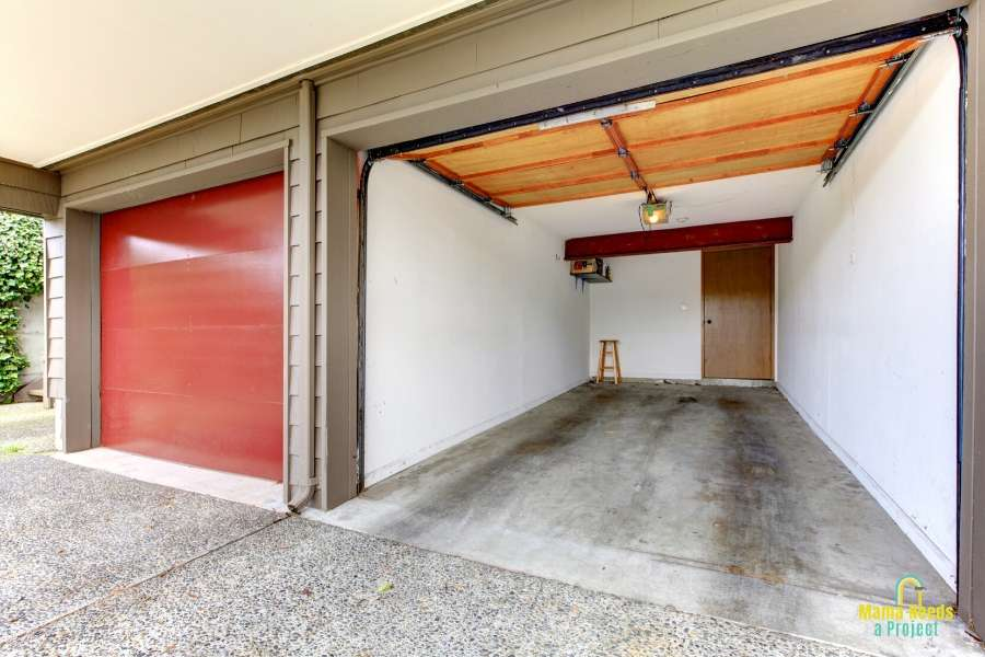 open door of an empty small one car garage