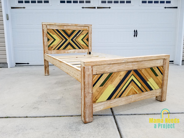 diy twin bed frame with geometric design on headboard and footboard assembed in a driveway