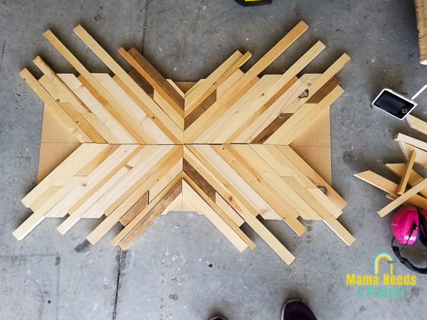 strips of wood laid out in geometric design on a piece of plywood