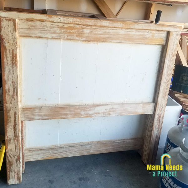twin headboard with paint stripped from outer frame