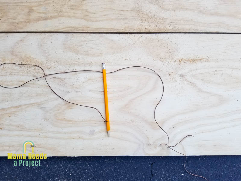 nail in a piece of plywood with a string tied to it and string tied to pencil