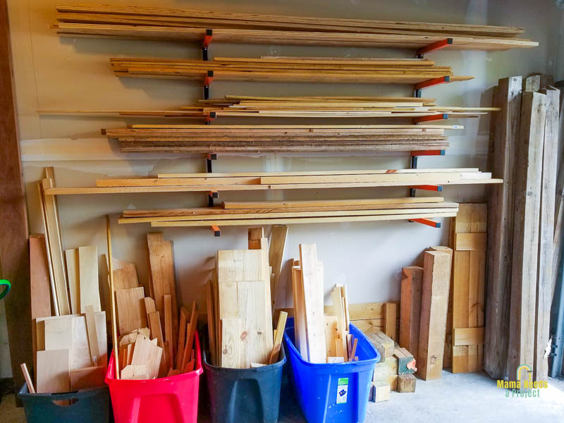 lumber storage rack installed in garage with lumber organized by type