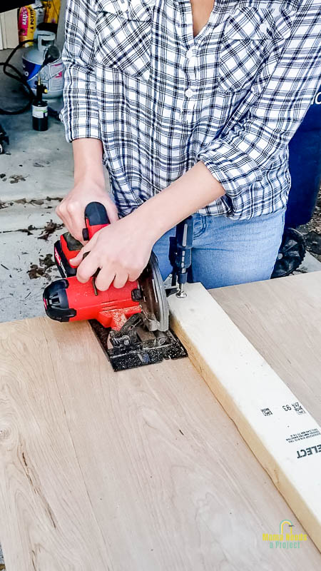 use a circular saw to cut sheets of underlayment into planks for diy shiplap