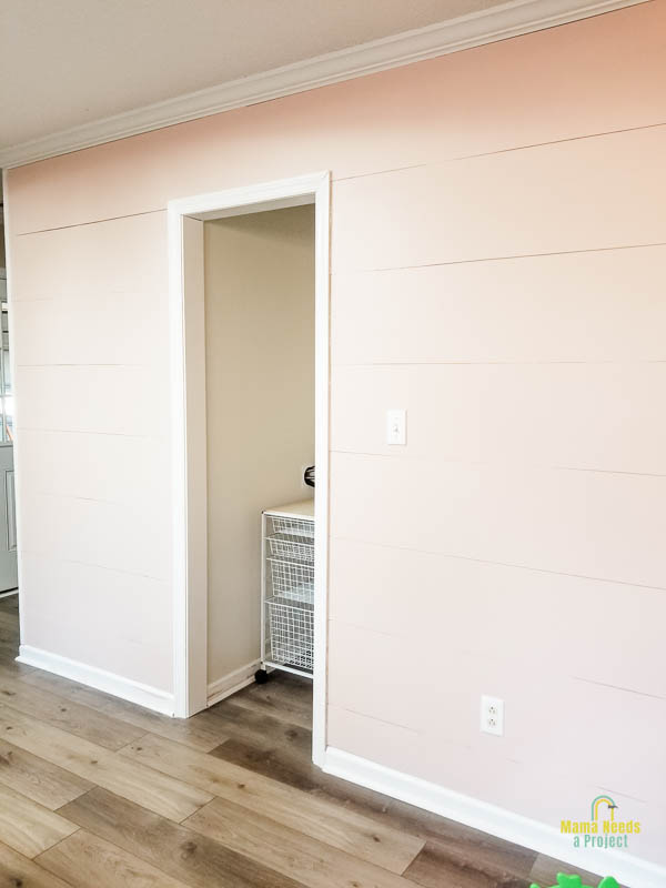 DIY modern shiplap wall finished and painted light pink