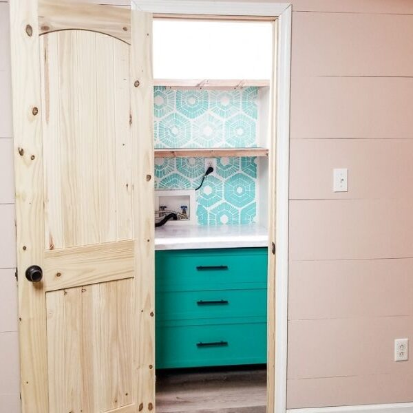 DIY small closet pantry with green drawers and a blue stenciled wall