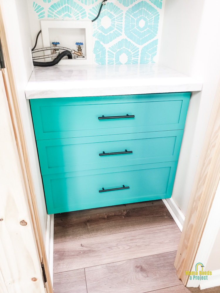 close up of DIY pantry drawers - greenish teal shaker style drawers with bar-style drawer pulls