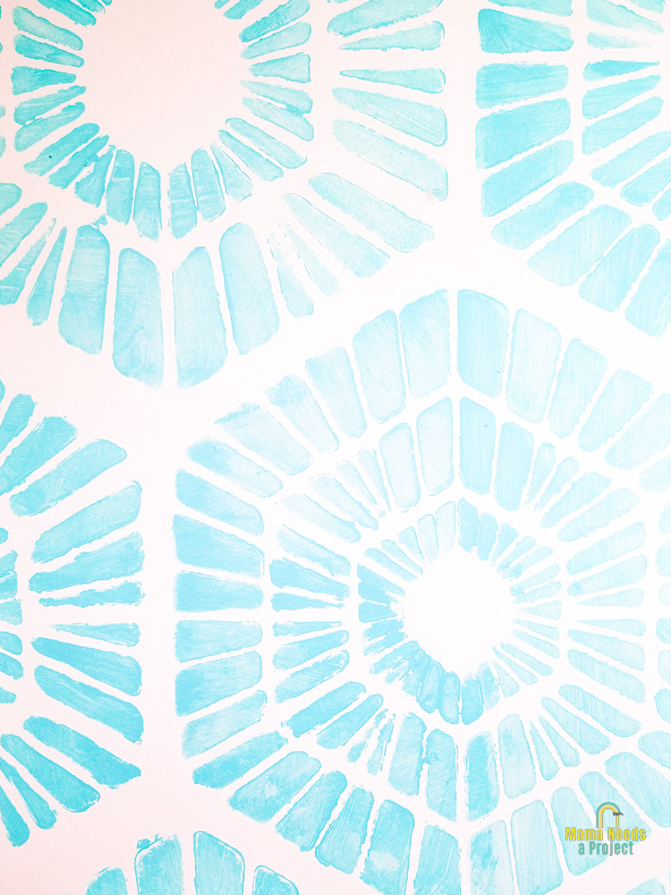 close up of blue stenciled wall in pantry