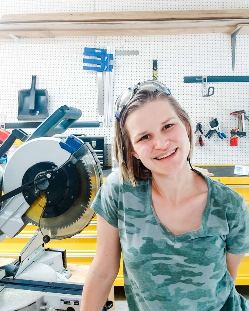 Emilee Anderson in front of saw