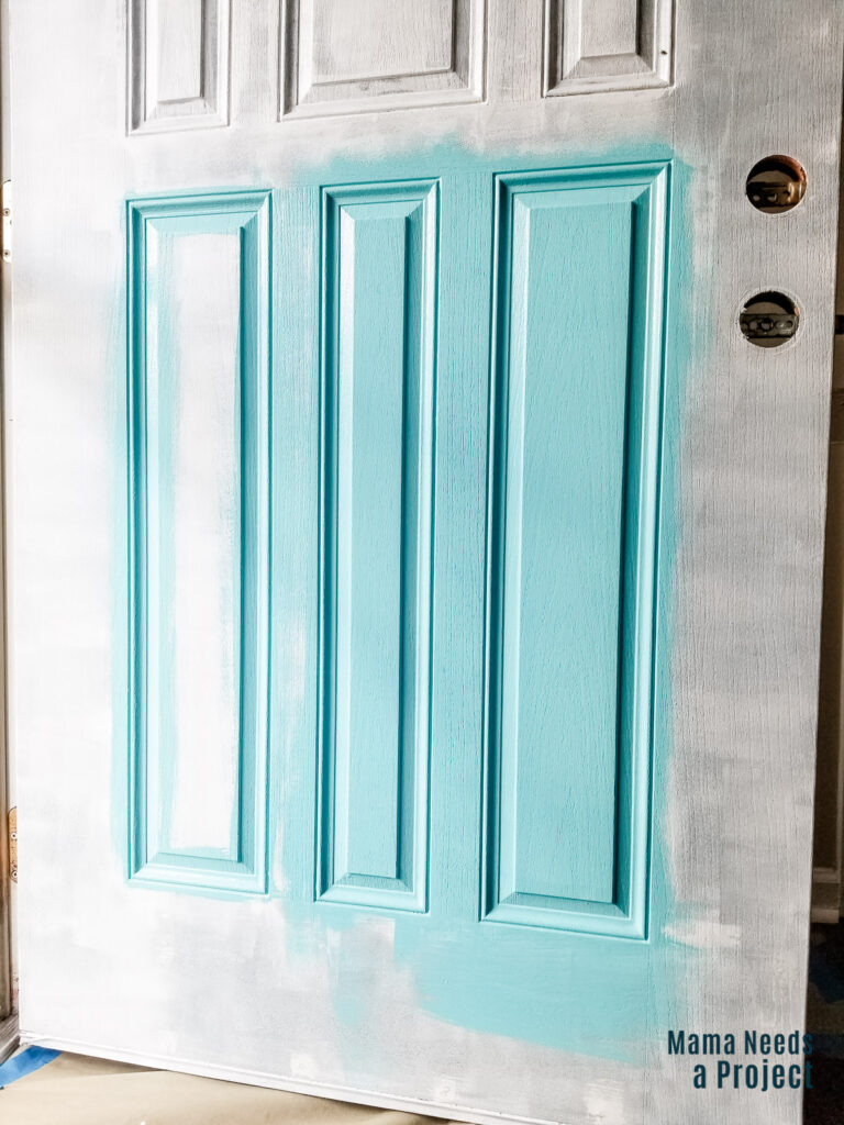 front door partially painted with blue paint