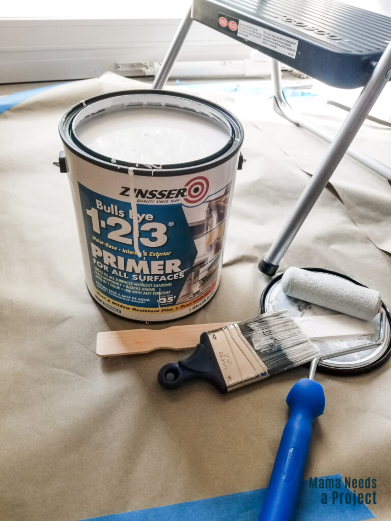 zinsser bulls eye primer 1 gallon can with an angled paint brush and 4-inch foam roller