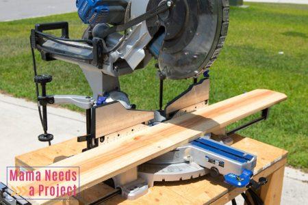 cut cedar fence pickets with miter saw to cut pieces for diy wedding center piece box