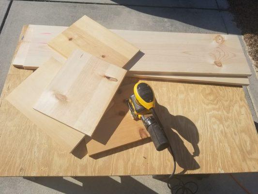Dewalt sander with cut 1x12 wood for modern toy storage book shelf