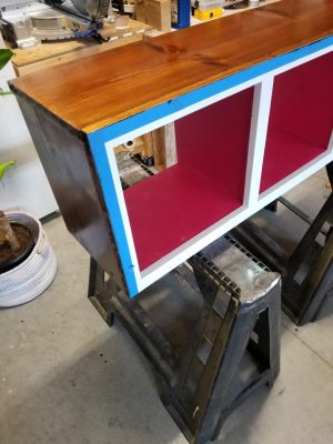 modern toy storage cubby shelf, blue painters tape on edge, outside stained, tutorial photo